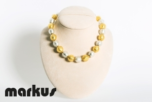 Glass necklace with round beads white and yellow gold leaf